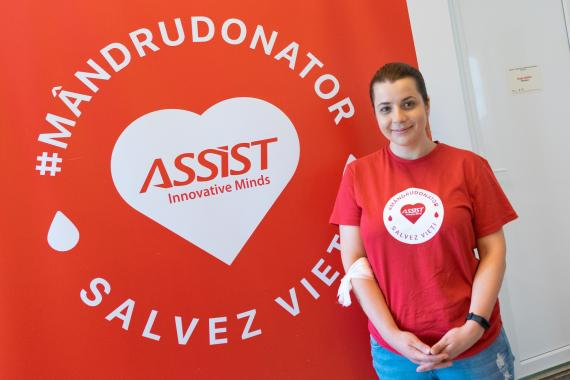Tatiana Brighidin - QA at ASSIST Software donating blood