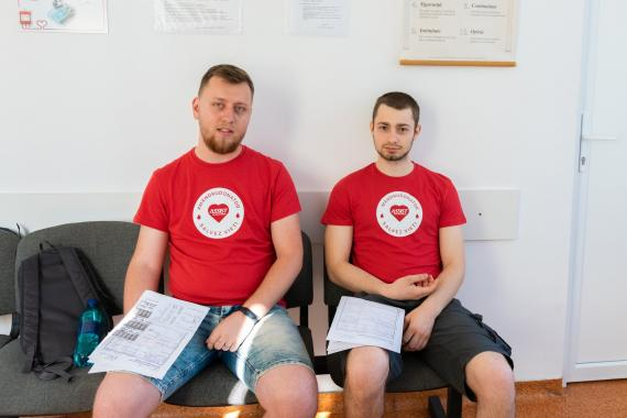 ASSIST Software employes reading the benefits of donating blood