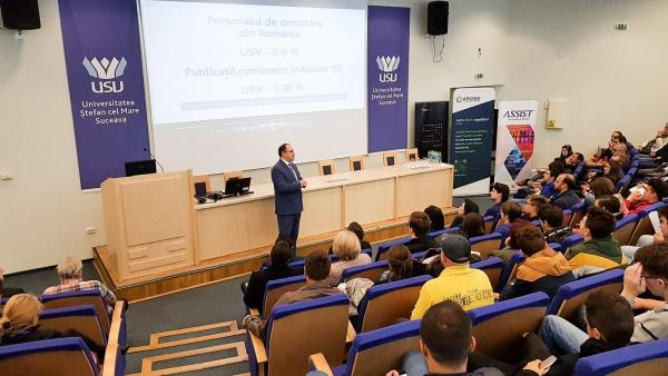 Mihai Dimian Professor and Vice-Rector at Stefan cel Mare University Suceava talking in front of high school students at the National Olympiad in Informatics 2019